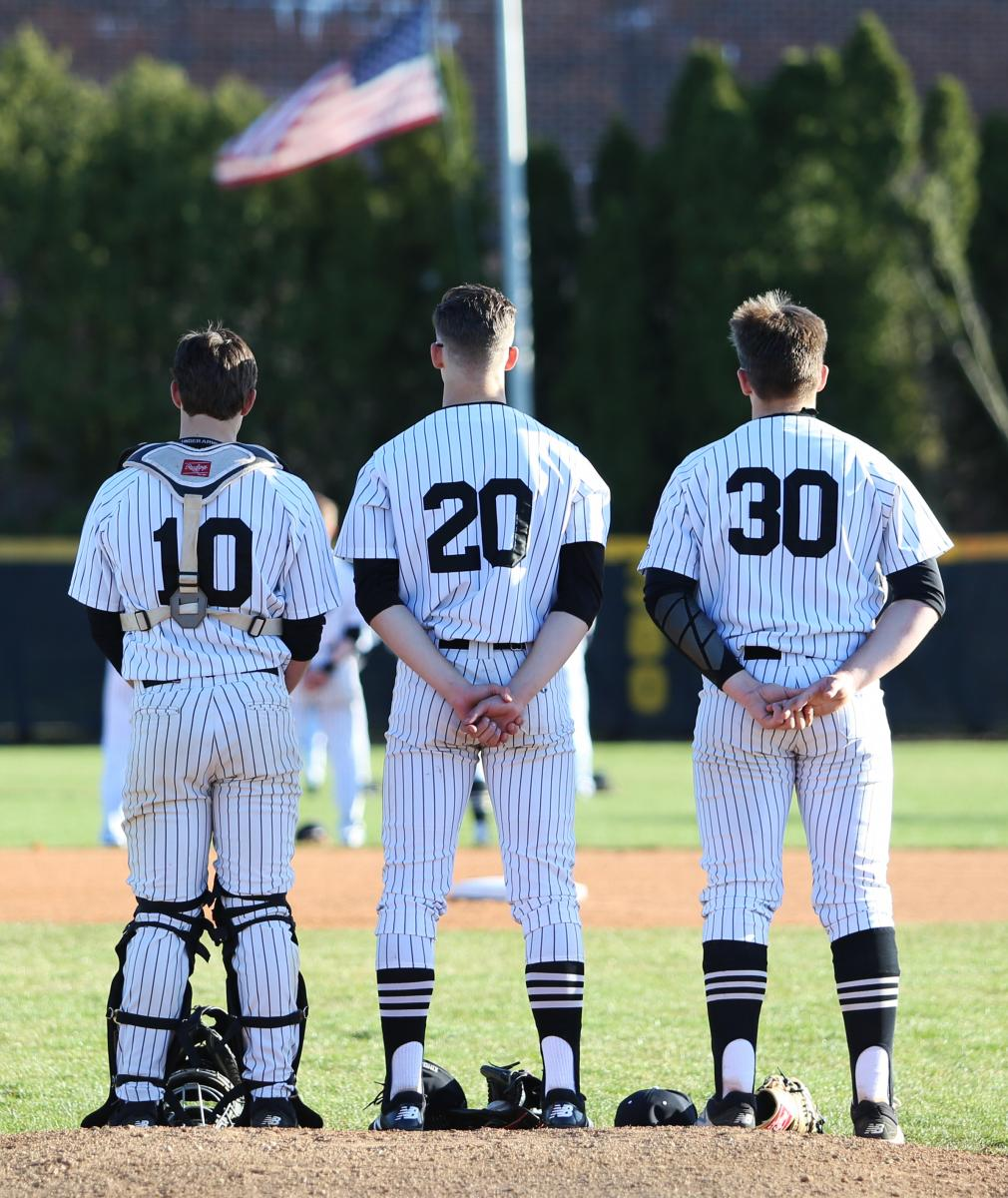 Penn Baseball players line up for the National Anthem.
