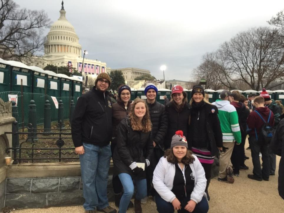 Penn students posing in front of the Capitol.