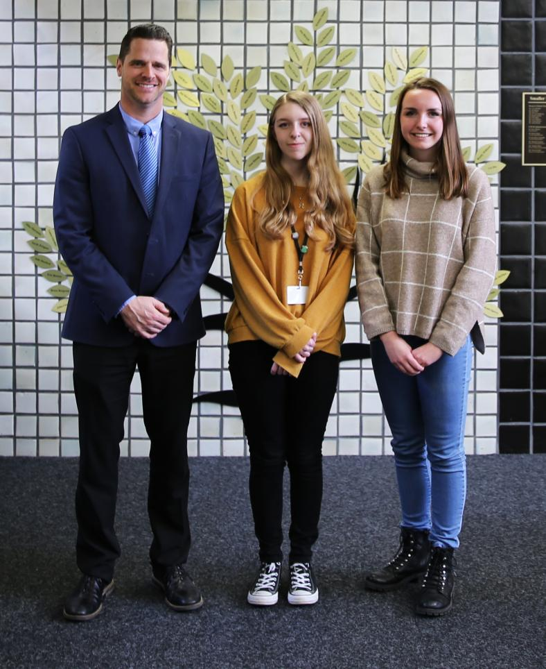 Penn High School Principal Sean Galiher and Silver Medal Award Winners in the National Scholastic Art competition, from left, Melina Tzanetatos and Camryn Murphy.
