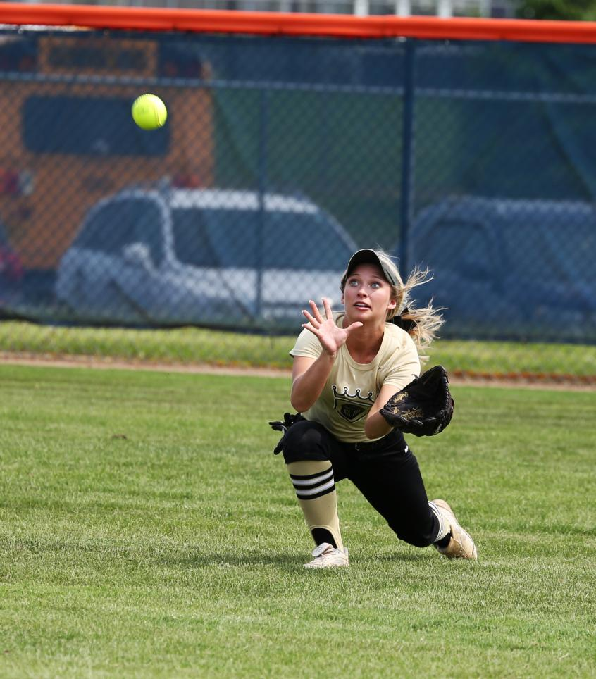 Ryleigh Langwell drives to make a catch in centerfield.