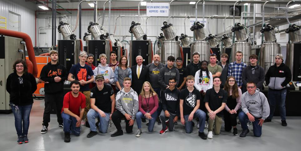 P-H-M Supt. Dr. Jerry Thacker, Penn Instructors Tara Pieters & Scott Shelhart, and Penn students at the Manufacturing Day Kickoff.