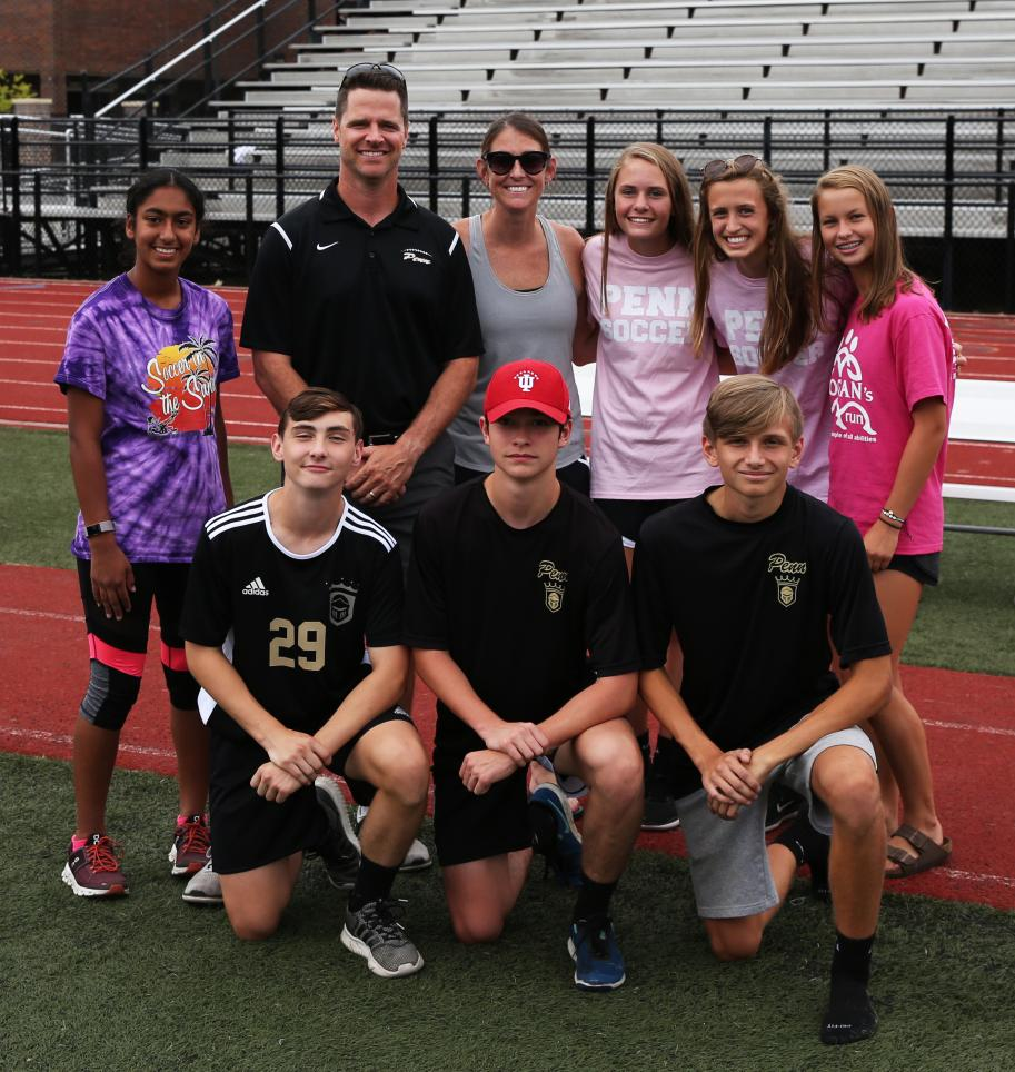 Penn High School Principal Sean Galiher, Assistant Athletic Director Bridget Williams, and Kingsmen student-athletes at the #KingsmenCookout.