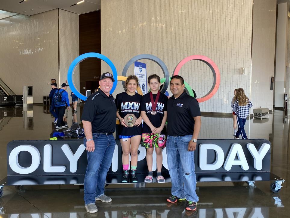 Left to right: Chad Harper, Julianna, Sister Ysabelle, Father Samuel Ocampo