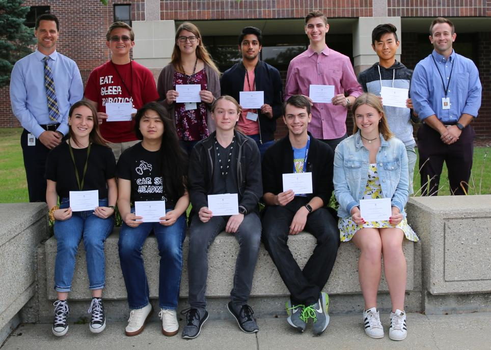 Penn High School Principal Sean Galiher, Director of Counseling John Westra, and Penn's National Merit Scholarship Commended Scholars.