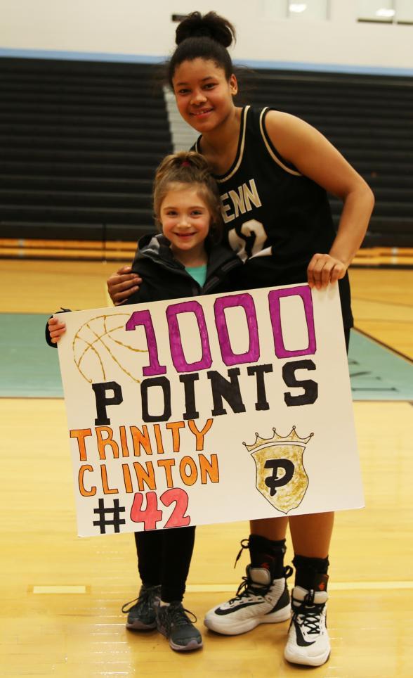 Penn's Trinity Clinton, with the daughter of Penn Girls Basketball Coach Kristi Ulrich.