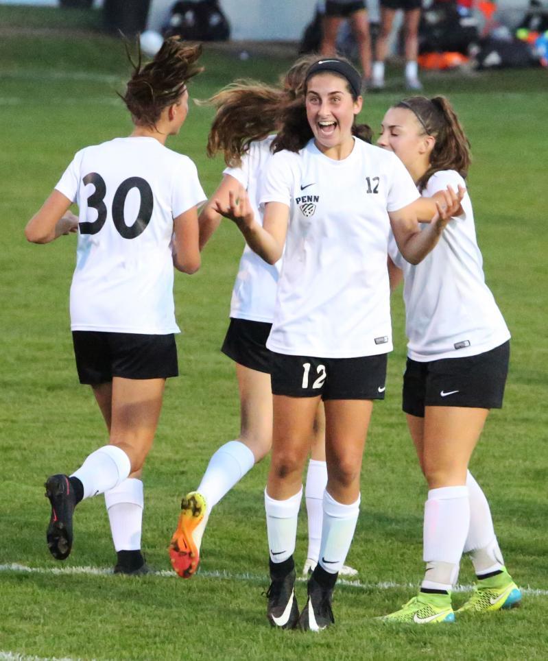 Maya Lacognato celebrates a goal.