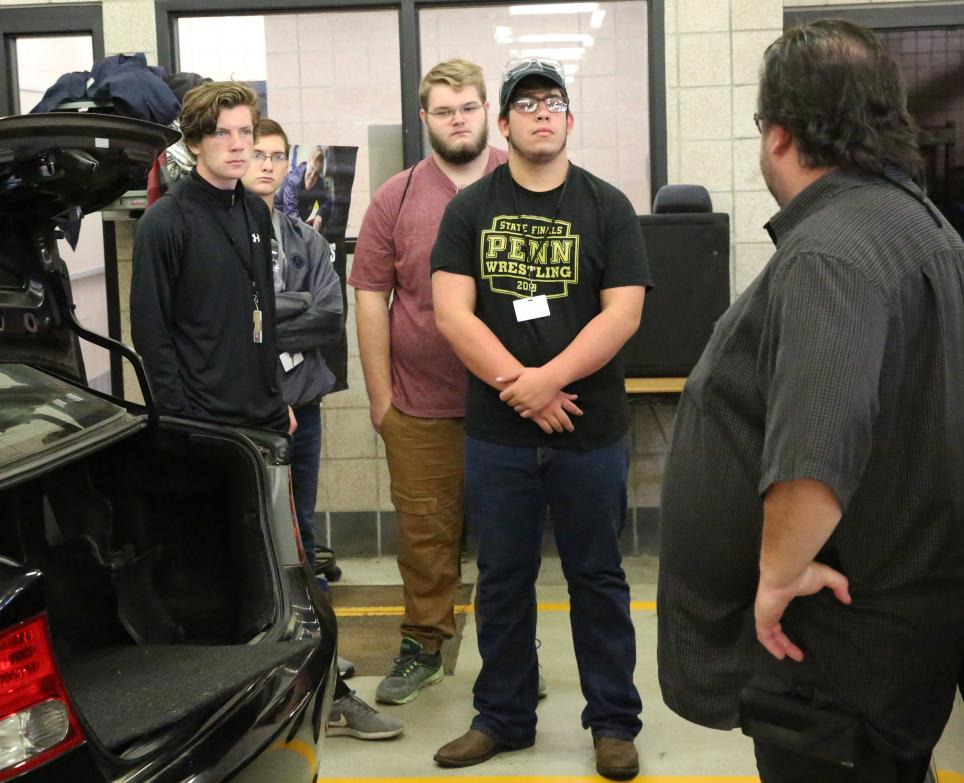 Penn students learn about the automotive engineering program at Ivy Tech.