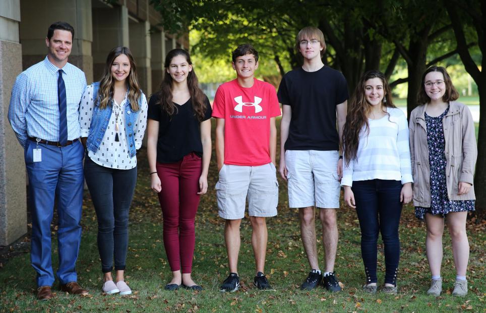 Penn High School Principal Sean Galiher, far left, and Penn's National Merit Scholarship Finalists: Kendra Laidig, Margaret Finnessy, Nicholas Casetti, Shane Hullinger, Renee Yaseen and Kristine Hocker.