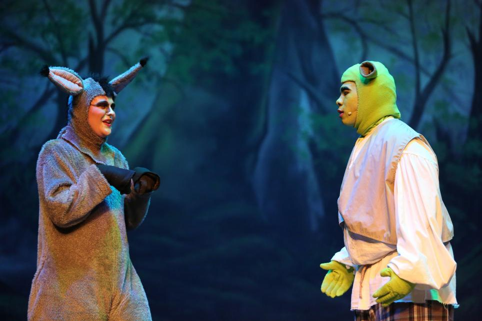 "Penn student Sam Robinson, left, as the character Donkey in the play ""Shrek"""