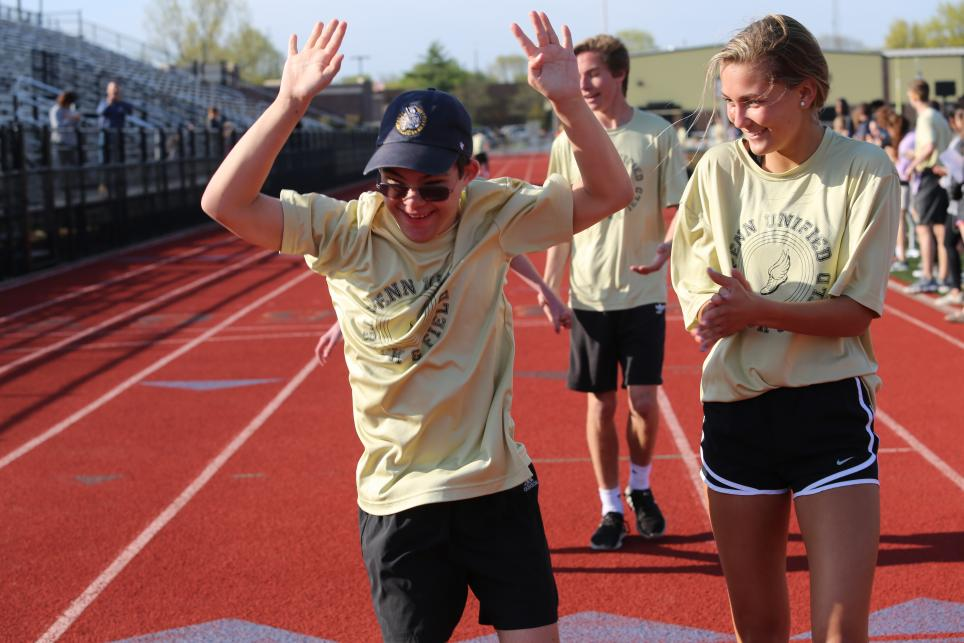 students rejoice after finishing a race