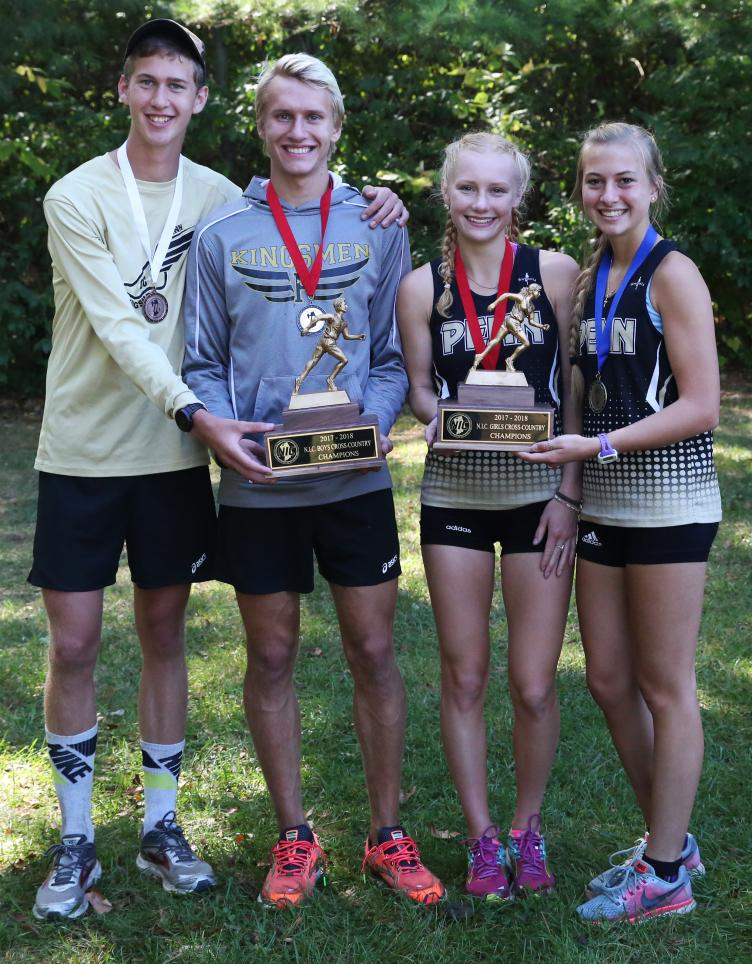 The Penn Boys and Girls Cross Country top finishers hold the Northern Indiana Conference Championships trophies.
