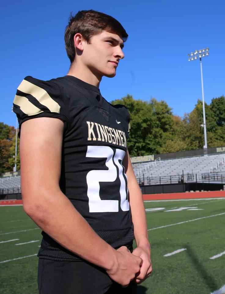 Penn Football Player Zack Messer models one of Penn's new football uniforms.