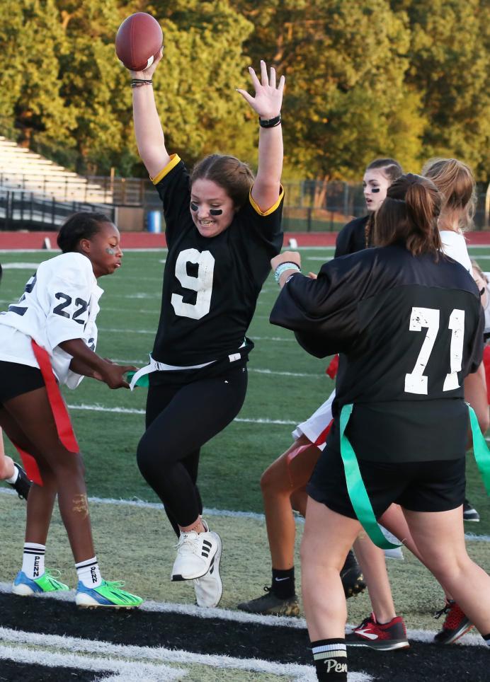 A Penn Powder Puff Football player scores a touchdown.