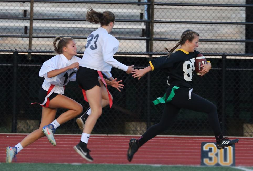 Cassie Norris sprints to the end zone on her way to a touchdown.