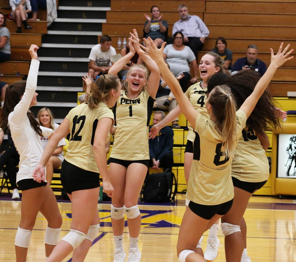 Penn Volleyball players celebrate a point.
