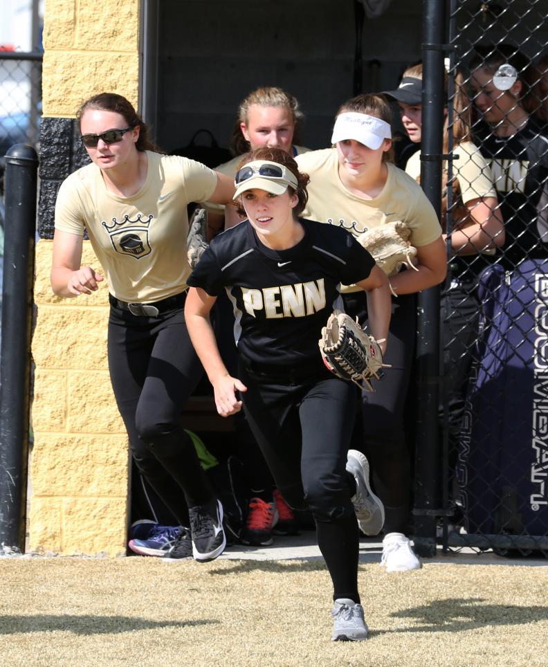 The Penn Kingsmen Softball Team sprints onto its new turf field.