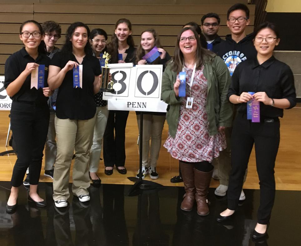 The Penn Spell Bowl Team poses with Blue Ribbons after winning the Kouts Invitational.