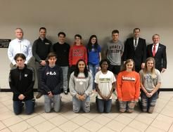 Penn-Harris-Madison School Corp. Supt. Dr. Jerry Thacker, P-H-M COO Aaron Leniski, Penn Principal Sean Galiher, Penn Athletic Director Jeff Hart and the 12 Kingsmen Student-Athletes who signed NCAA/NAIA letters of intent.