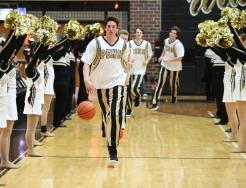 Penn Senior Leader Noah Krathwohl leads the Kingsmen onto the court.