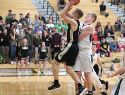 Drew Lutz drives to the hoop for a score in the second overtime.