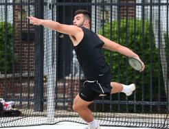 Penn's Caden Paquette unleashes a school-record throw in the discus.
