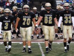 The Captains of the Penn Football Team walking out to the center of the field for the coin toss.