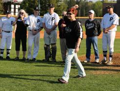 Becky Lutkus throws out the first pitch.