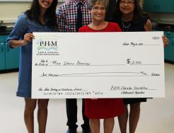 From left, Darla Lippert, Sean Galiher, Diane Bowersox and Mari Linn Wise  at the presentation of the P-H-M Education Foundation Jeneane Arter Teaching in Excellence Award.