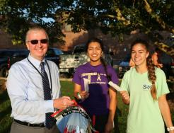 Dr. Thacker handing out popsicles