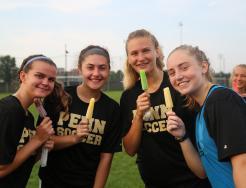 Girls soccer players enjoy their popsicles