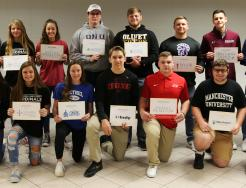 Penn Athletic Director Jeff Hart, Penn Principal Sean Galiher, and P-H-M Supt. Dr. Jerry Thacker and Penn's 15 National Signing Day participants.