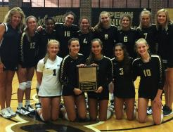 The Penn Varsity Volleyball Team celebrates winning the Tom Heck Invitational Championship.