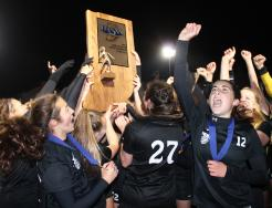Penn Girls Soccer players celebrate winning the State Championship.