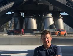 Jon Edwards in front of Falcon 9 rocket