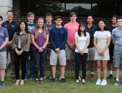 Principal Sean Galiher and Penn's 2019 National Merit Scholarship Semifinalists.
