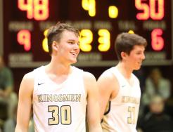 Noah Applegate smiles as the Kingsmen Boys Basketball Team locks up a victory against Mishawaka in the Sectional.