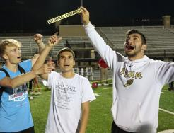 Regional Champions, from left, Kevin Krutsch, Mariano Retzloff and Caden Paquette celebrate Penn's Team Regional Championship.