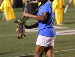 A saxophone player performs in the Penn Marching Band.