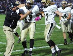 Cory Yeoman celebrates with Paul Moala and Ryan Schmitt after a fumble recovery.
