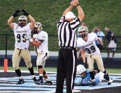 James Morris and the referee signal safety for the Kingsmen after Mason sacked the St. Joseph quarterback.