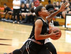 Penn's Trinity Clinton drives to the hoop.