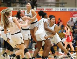 Penn Girls Basketball players celebrate after stunning No. 2 and unbeaten Crown Point.