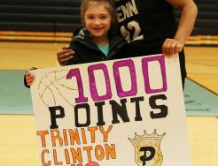 Penn's Trinity Clinton, with the daughter of Penn Girls Basketball Coach Kristi Ulrich.