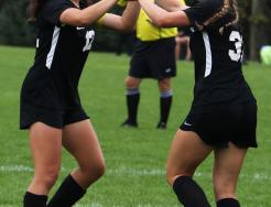 Maya Lacognato and Lauren Hamilton celebrate a Penn goal.