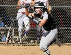 Ryleigh Langwell celebrates as she heads toward home plate after hitting a home run.