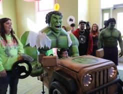 """Zephan Cantu in his """"Hulk Smash Machine"""" with Mom & Dad Leann and Lupe Cantu"""