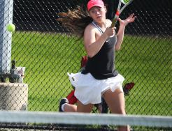 Penn's No. 1 Singles player Jamie Hurst blasts a return shot.