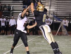 Penn linebacker Caden Paquette pressures Warsaw's quarterback.