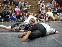 Tanner DeMien looks for the pin.