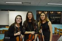 Maddi Grace, Amira Oudghiri, and Brittney Vetter pose for a photo before performing.